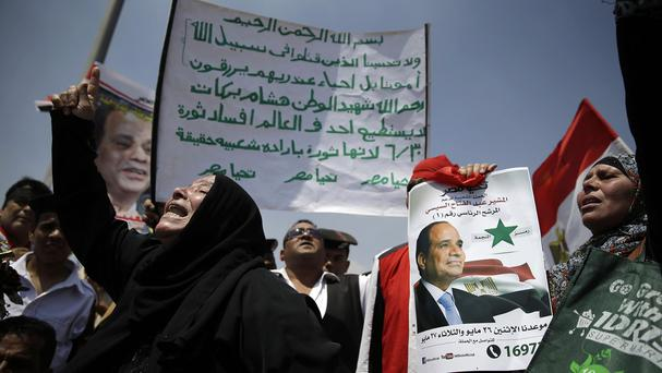 A woman chants pro-government slogans during the funeral of Egyptian prosecutor Hisham Barakat (AP)
