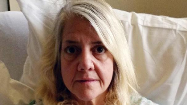 The woman in hospital after being found in Carlsbad, California (Interpol/AP)