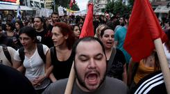 Demonstrators shout slogans during a rally by supporters of the No vote in the upcoming referendum in the northern Greek port city of Thessaloniki (AP)