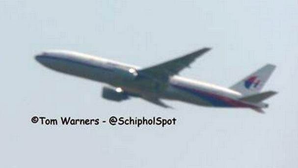 This photo from Tom Warners' Twitter feed shows what is believed to be Malaysia Airlines flight MH17 taking off off from Schiphol (Tom Warners/PA)