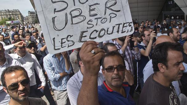 Striking taxi drivers during a demonstration in Paris. (AP)