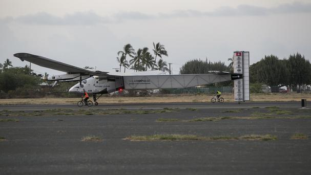 The Solar Impulse 2, a solar-powered plane, lands at Kalaeloa Airport in Kapolei, Hawaii (AP)