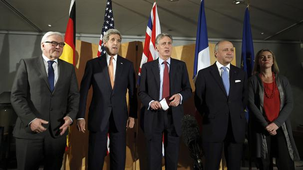 John Kerry and Philip Hammond, centre, have been part of recent negotiations with Iran over the nuclear programme