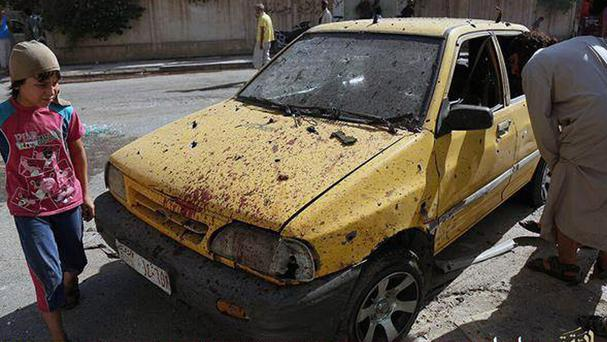 A car purportedly damaged by US-led air strikes on Raqqa, Syria (Islamic State militant website via AP)