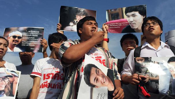 Supporters of 14 detained students protest outside the military court in Bangkok, Thailand (AP)