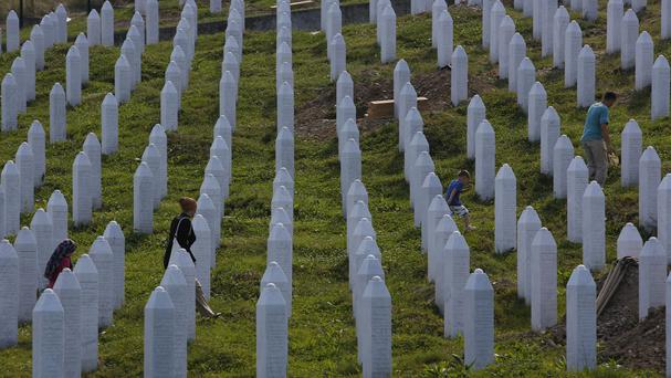People visit graves at a memorial centre in Potocari, near Srebrenica, 150km north east of Sarajevo, Bosnia (AP)