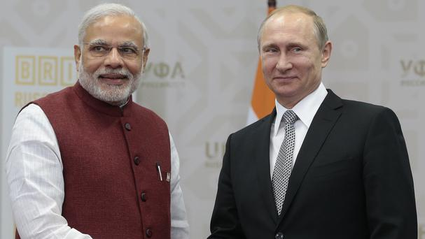 Russian president Vladimir Putin shakes hands with Indian prime minister Narenda Modi in Ufa (AP)