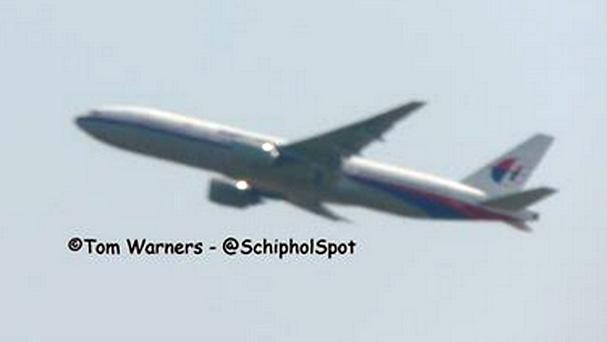 This photo from Tom Warners' Twitter feed shows what is believed to be Malaysia Airlines flight MH17 taking off from Schiphol (Tom Warners/PA)
