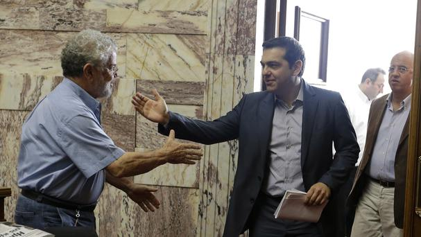 Prime Minister Alexis Tsipras arrives for a meeting at the Greek Parliament in Athens (AP)