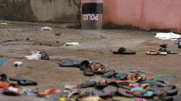 Slippers lie strewn around at the site of a stampede in the town of Mymensingh. (AP)