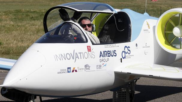 French pilot Didier Esteyne prepares to exit the cockpit after crossing the Channel in an Airbus electric plane. (AP)