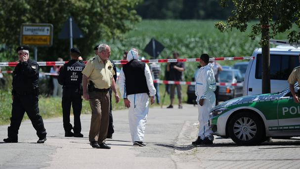 Police inspect the scene of a shooting in Tiefenthal near Ansbach, Germany (AP)