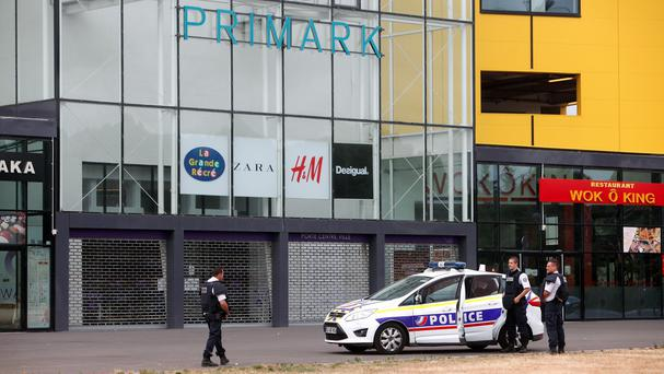Police officers outside the Primark store near Paris that was hit by robbers (AP)