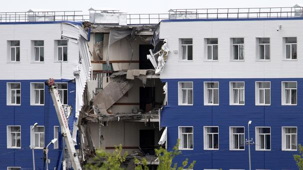 The collapsed barrack at a base in Omsk, Russia. (AP)