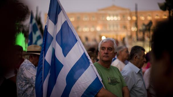 Demonstrators gather near the Greek Parliament during a rally in Athens against the government's agreement with its creditors (AP)