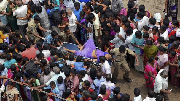 A woman is rushed to a hospital on a stretcher after a stampede during a Hindu religious bathing festival on the bank of the Godavari River in Rajahmundry, Andhra Pradesh state, India (AP)