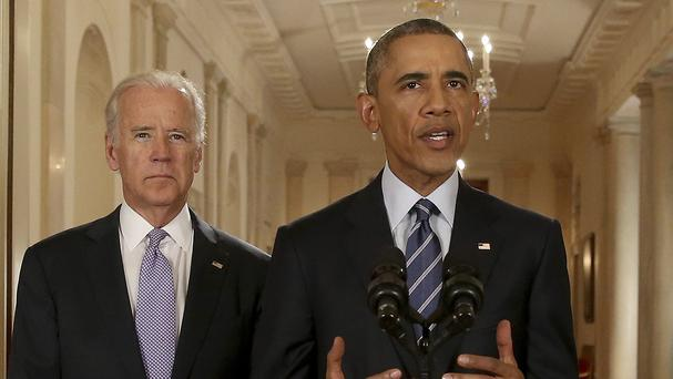 President Barack Obama, standing with vice president Joe Biden, speaks at the White House after the Iran nuclear deal was struck (AP)