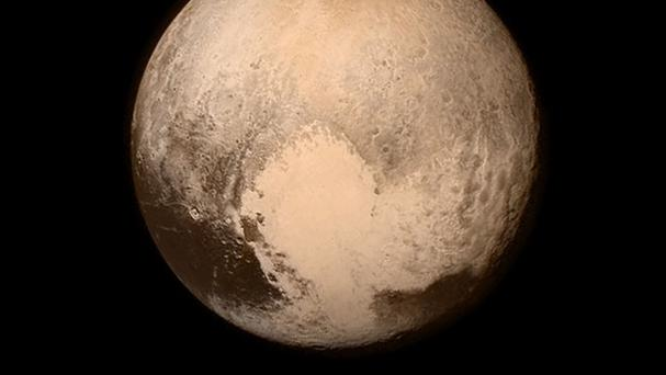 The dwarf planet Pluto, pictured about 16 hours before the New Horizons craft reached its moment of closest approach (Nasa)