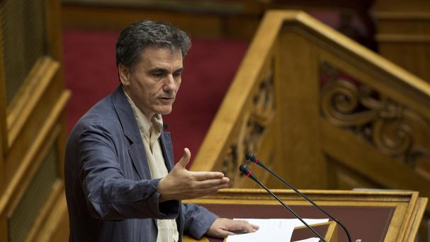 Greece's Finance Minister Euclid Tsakalotos gives a speech during a parliament session in Athens. (AP)