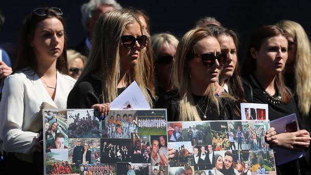 Mourners attend the funeral of Eoghan Culligan, in Dublin, after he died when a balcony collapsed in Berkeley, California.
