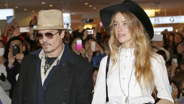 Johnny Depp and wife Amber Heard (AP)