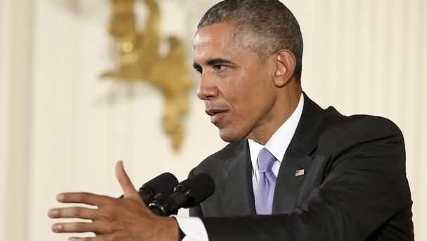Barack Obama makes his point during the White House news conference (AP)