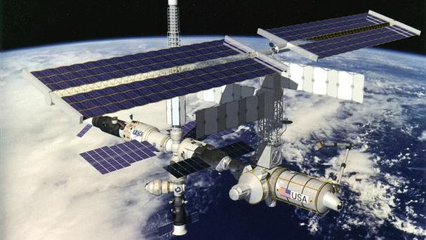A piece of space junk forced the three space station astronauts to seek emergency shelter.