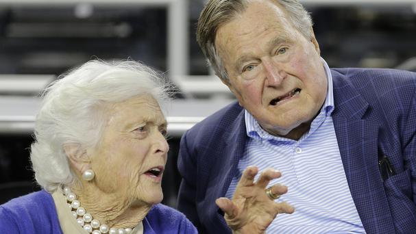 Former US president George HW Bush fractured a bone in his neck (AP)