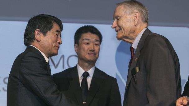 Left to right, Mitsubishi Materials executives Yukio Okamoto and Hikaru Kimura apologise and shake hands with 94-year-old ex-PoW James Murphy (AP)