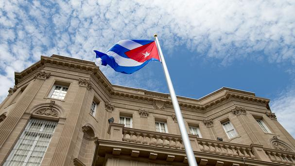 The Cuban flag is raised over their new embassy in Washington (AP)
