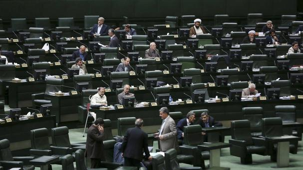Iranian politicians attend an open session of parliament in Tehran (AP)
