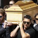 Formula One drivers carry the casket of French driver Jules Bianchi into Sainte Reparate Cathedral during his funeral in Nice (AP)