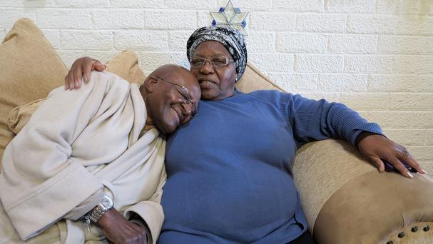 Desmond Tutu, left, with his wife Leah at their home in Cape Town after he returned home following a week in hospital (Oryx Media/AP)