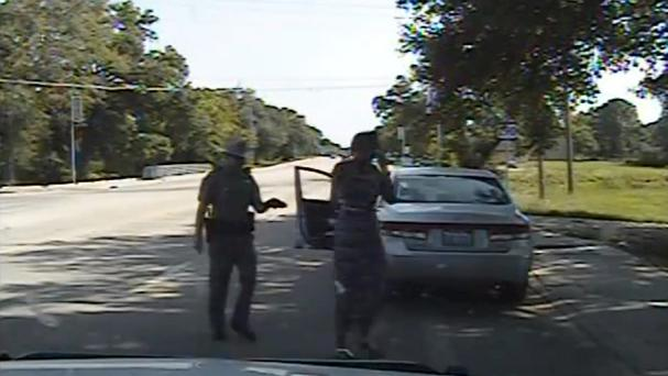An image taken from a dashcam video as officer Brian Encinia arrests Sandra Bland in Texas (AP)