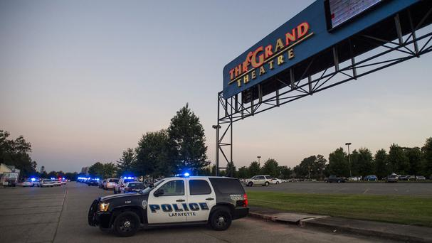A Lafayette Police Department vehicle blocks an entrance at the Grand Theatre following a shooting (AP)