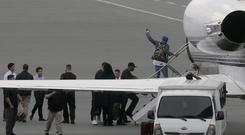 Grammy award-winning singer Chris Brown boards a chartered jet at Manila Domestic Airport (AP)