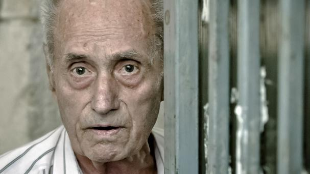 Alexandru Visinescu has been jailed for 20 years after being convicted of crimes against humanity in the deaths of 12 prison inmates (AP)
