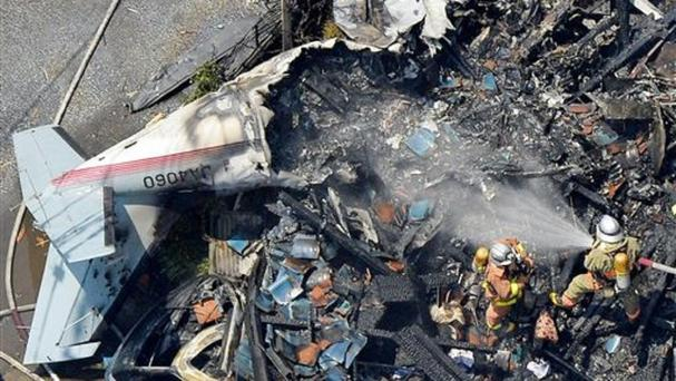 The wreckage of a plane is seen at a crash site in the suburbs of Tokyo (Kyodo News/AP)