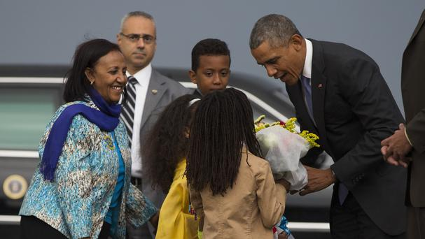 President Barack Obama received flowers at Addis Ababa airport