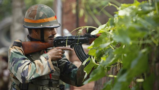 An Indian army soldier during a gunfight in the town of Dinanagar, in the northern state of Punjab, India. (AP)
