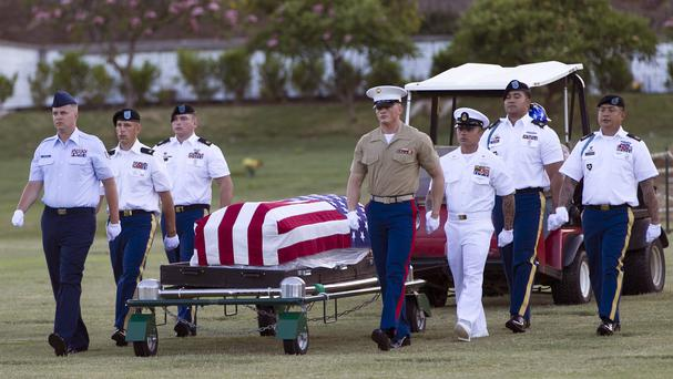 The exhumed remains of unidentified crew members of the USS Oklahoma are transported to a laboratory (AP)