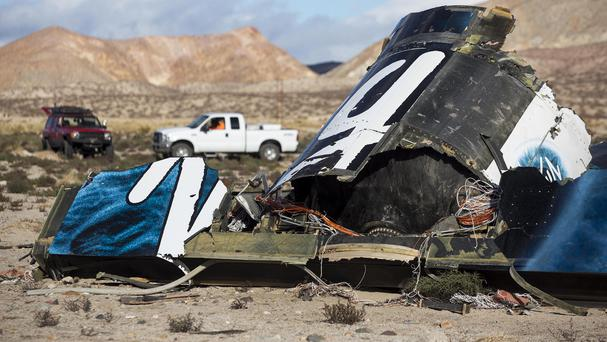 Wreckage lies near the site where Virgin Galactic space tourism rocket SpaceShipTwo exploded and crashed in Mojave, California (AP)