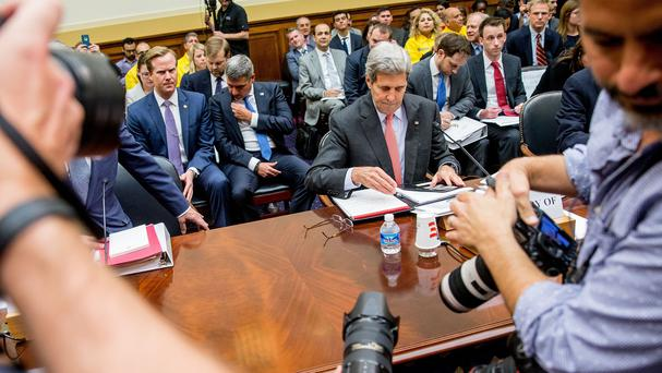 Secretary of State John Kerry (pink tie) prepares to testify on Capitol Hill before the House Foreign Affairs Committee hearing on the Iran nuclear agreement (AP)