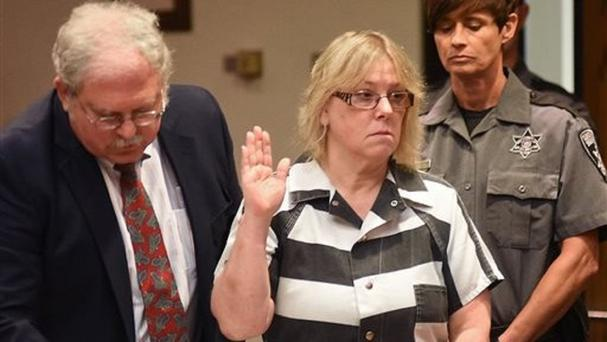 Joyce Mitchell raises her hand during a court appearance in Plattsburgh, New York (Rob Fountain/The Press-Republican/AP)