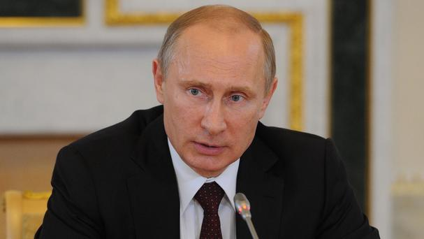 Russia will veto a UN Security Council resolution on a plane crash in Ukraine, Vladimir Putin has said (PA/ITAR-TASS)