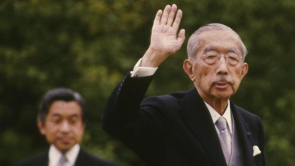 Emperor Hirohito pictured in 1988 waving as his son, Crown Prince Akihito, looks on during an imperial garden party in Tokyo (AP)