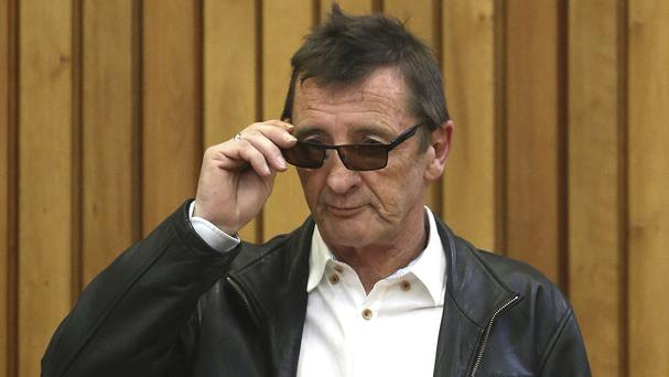 AC/DC drummer Phil Rudd appears at Tauranga District Court (New Zealand Herald/AP)