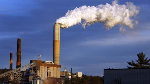 Barack Obama is unveiling the final version of unprecedented regulations clamping down on carbon dioxide emissions from existing US power plants (AP)