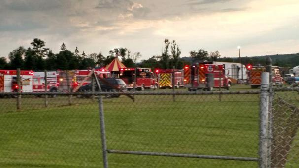 Officers surround the scene of the circus tent collapse in Lancaster, New Hampshire (AP)