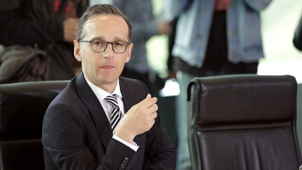 German justice minister Heiko Maas said he would request the prosecutor's retirement (AP)